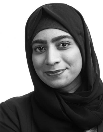 corporate portrait of smiling woman wearing hijab