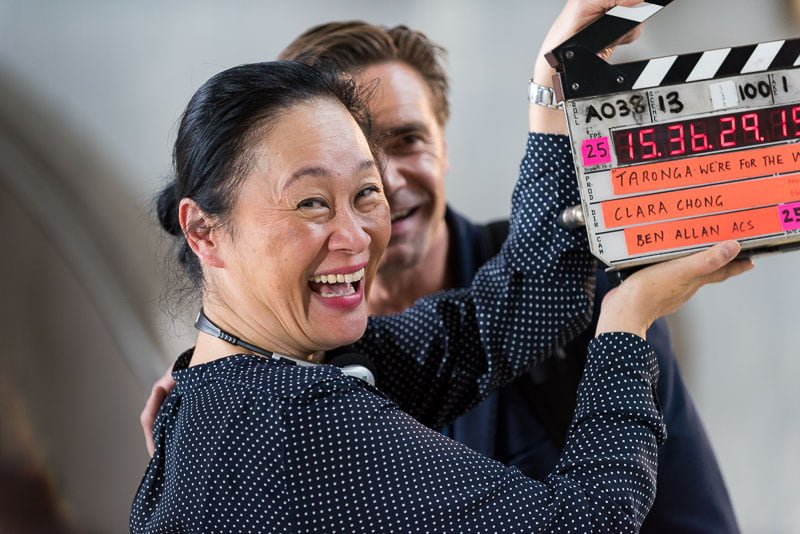 Clara Chong film director with clapboard