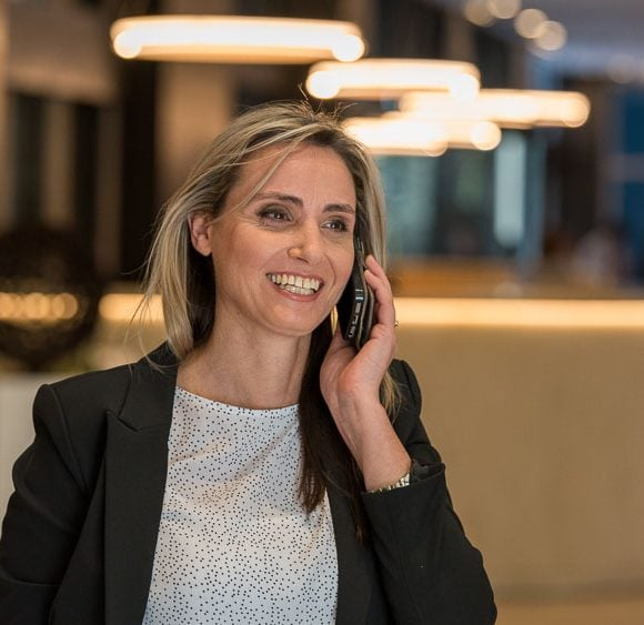 on-location portrait of a woman on phone call in public setting